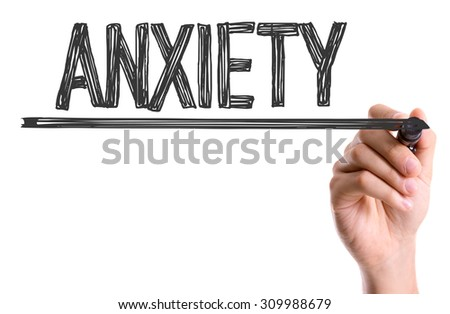 Hand with marker writing the word Anxiety - stock photo