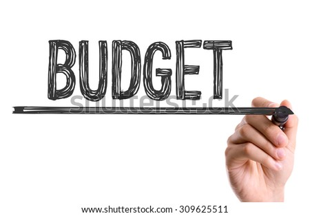 Hand with marker writing the word Budget - stock photo