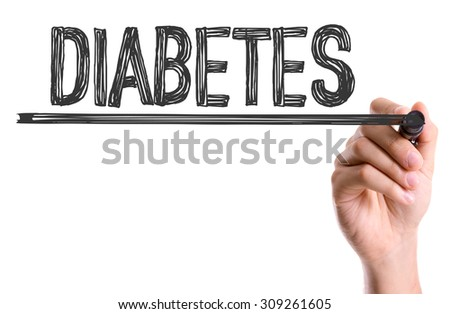 Hand with marker writing the word Diabetes - stock photo