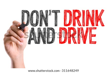 Hand with marker writing the word Don't Drink and Drive - stock photo