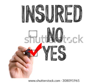 Hand with marker writing the word Insured - Yes - stock photo