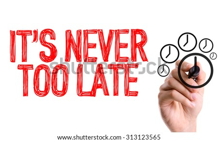 Hand with marker writing the word Its Never Too Late - stock photo