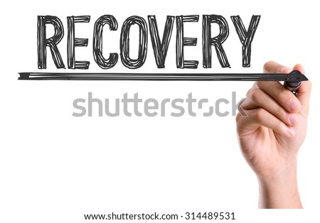 Hand with marker writing the word Recovery - stock photo