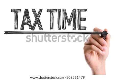 Hand with marker writing the word Tax Time - stock photo