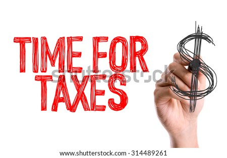 Hand with marker writing the word Time for Taxes - stock photo