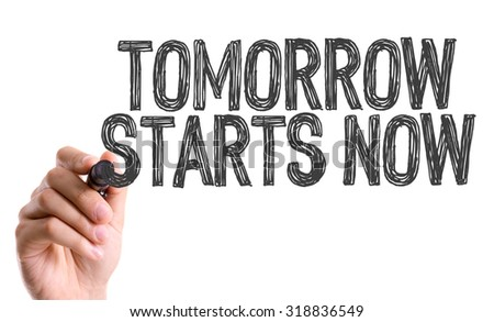 Hand with marker writing: Tomorrow Starts Now - stock photo