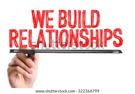 Hand with marker writing: We Build Relationships - stock photo