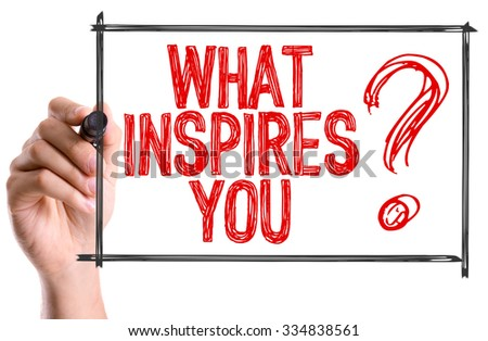 Hand with marker writing: What Inspires You? - stock photo