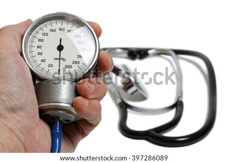 Hand with medic instrument for measuring blood pressure - Professional Blood Pressure Kit with Pressure Cuff isolated on white with shadow. Shallow focus. - stock photo