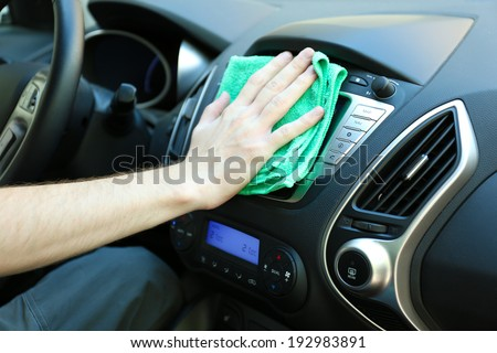 hand cleaning car steering wheel microfiber stock photo. Black Bedroom Furniture Sets. Home Design Ideas