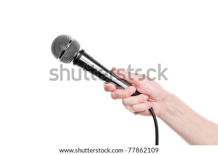 Hand with microphone isolated on white background - stock photo