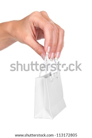 Hand with mini gift bag, isolated on white background - stock photo