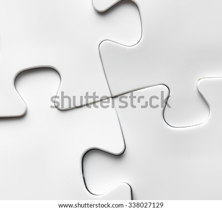 Hand with missing jigsaw puzzle piece. Business concept image for completing the final puzzle piece. - stock photo
