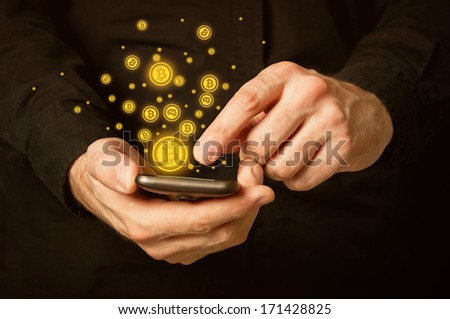 Hand with mobile smart phone and bitcoin currency symbol - stock photo