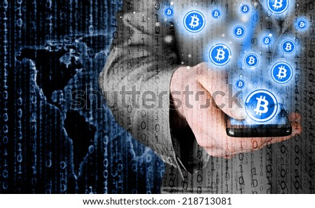 Hand with mobile smart phone and bitcoin symbol - stock photo