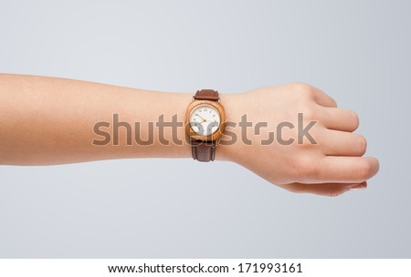 Hand with modern watch showing precise time - stock photo