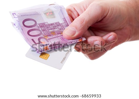 hand with money  and credit card - stock photo