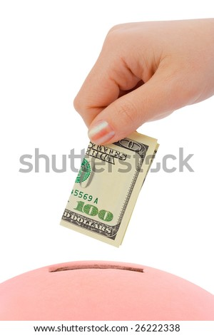Hand with money and piggy bank isolated on white background