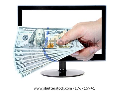 hand with money comes from Computer monitor isolated on white - stock photo