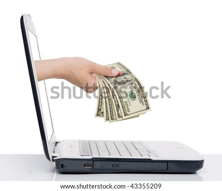 hand with money comes from laptop screen isolated on white - stock photo