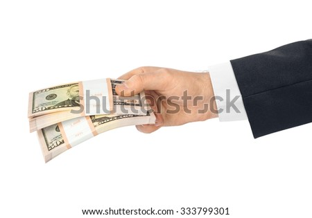 Hand with money isolated on white background - stock photo