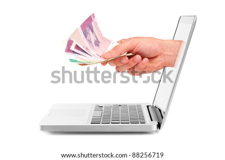 hand with money out of laptop display - stock photo
