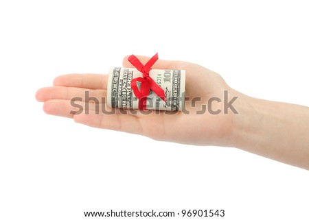 Hand with money present on white background - stock photo