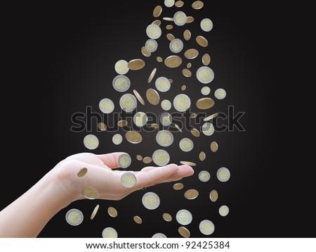 Hand with money rain - stock photo