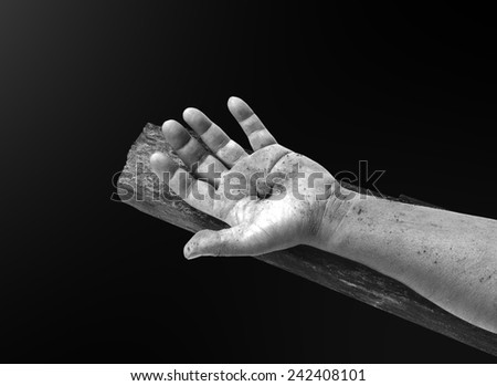 Hand with nail on the cross. Christmas background, Forgiveness, Mercy, Humble, Repentance, Reconcile, Adoration, Glorify, Redeemer, Redemption, Gospel, Love, Faith, Hope concept. - stock photo