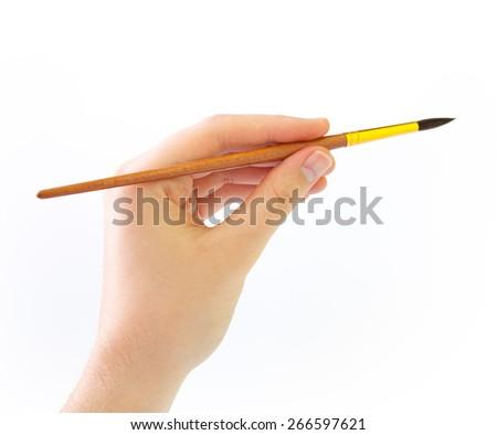 Hand with paintbrush - stock photo