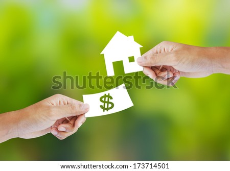 Hand with paper money and house shape. new house buy concept - stock photo
