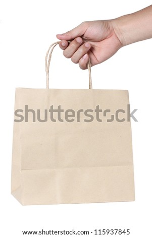 Hand With Paper Shopping Bag Isolated On White - stock photo