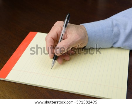 Hand with pen and paper