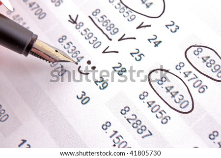 Hand with pen calculate income