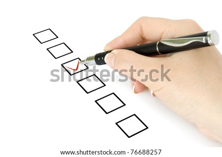 Hand with pen choosing one of three options - stock photo
