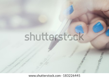 Hand with pen choosing the test list on the examination - stock photo
