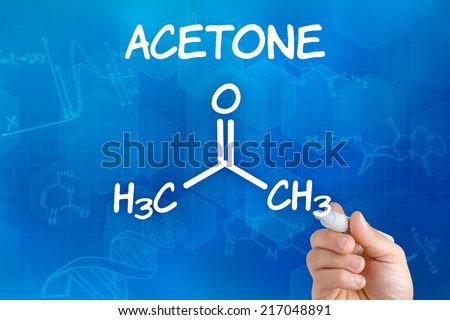 Hand with pen drawing the chemical formula of Acetone