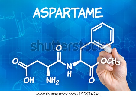 Hand with pen drawing the chemical formula of aspartame - stock photo