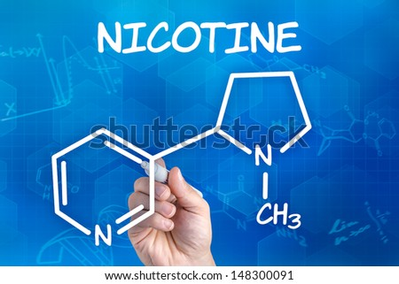 hand with pen drawing the chemical formula of nicotine - stock photo
