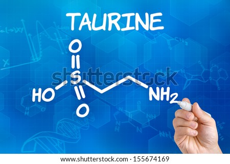 Hand with pen drawing the chemical formula of taurine - stock photo