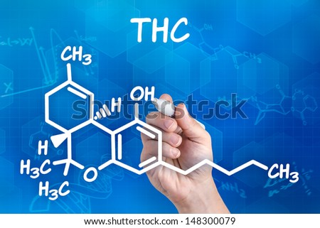 hand with pen drawing the chemical formula of thc - stock photo