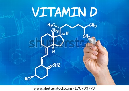 Hand with pen drawing the chemical formula of vitamin d - stock photo