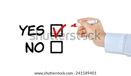 Hand with pen filling out a checklist - Yes or No - stock photo