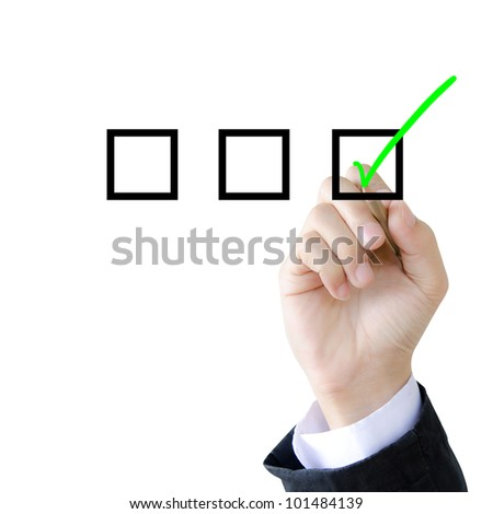 hand with pen mark the check boxes. - stock photo