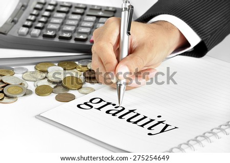 Hand with pen pointing to gratuity word on the paper - stock photo