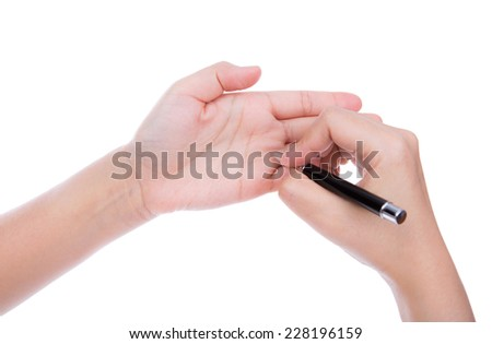 Hand with pen write something on own hand instead paper isolated on white background - stock photo