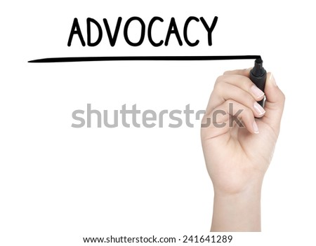 Hand with pen writing ADVOCACY on whiteboard - stock photo