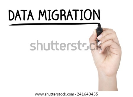 Hand with pen writing DATA MIGRATION on whiteboard - stock photo