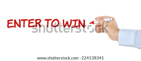 Hand with pen writing Enter to win - stock photo