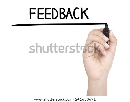 Hand with pen writing FEEDBACK on whiteboard - stock photo